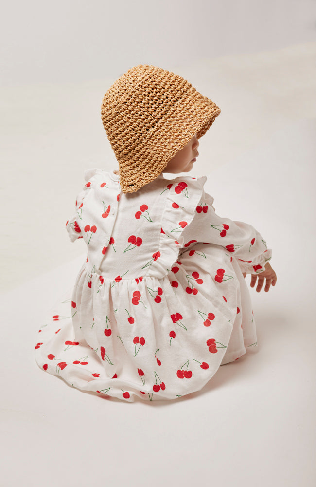 Ella summer raffia bonnet with black ribbon ties and cherry print winnie dress for babies and kids