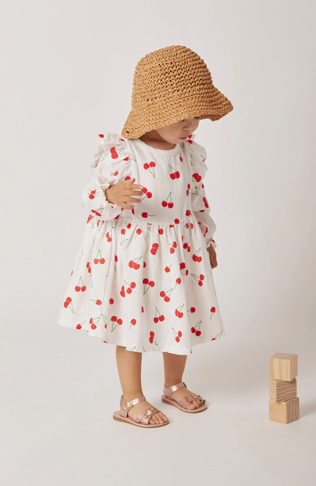 Winnie red cherry print long sleeve ruffle dress for toddlers and kids front view