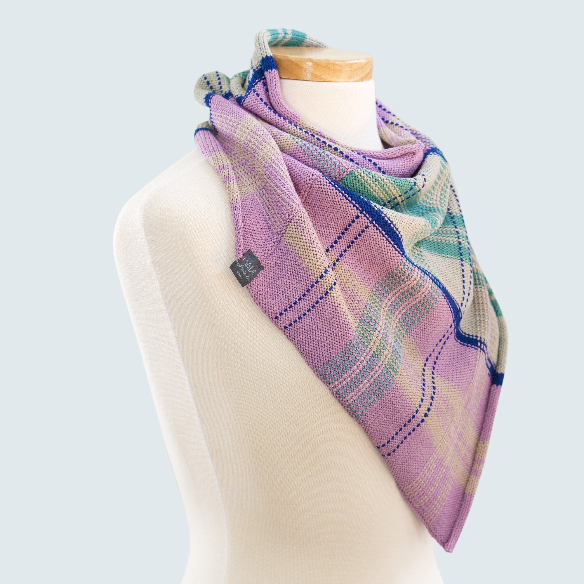 Side view of spring bandana cowl scarf in wool cotton blend with tartan design in purple, grey, blue and green