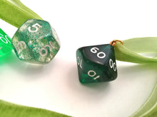 Polyhedral Dice on Green Choker