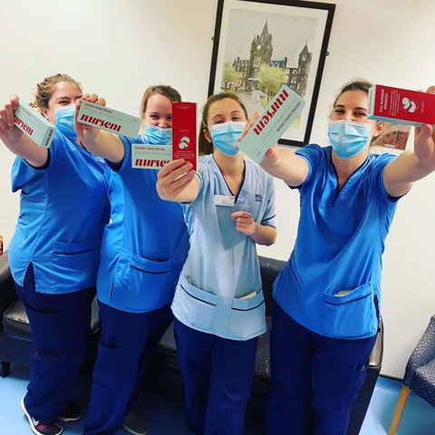 Nurses holding up Nursem hand cream