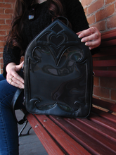 Load image into Gallery viewer, A black purse designed like a Gothic cathedral window.