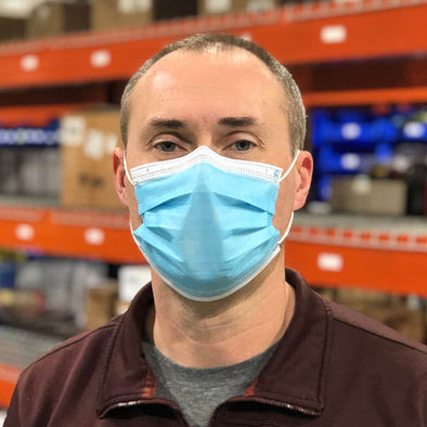 man wearing a Disposable 3-Ply Surgical Mask FDA-Approved