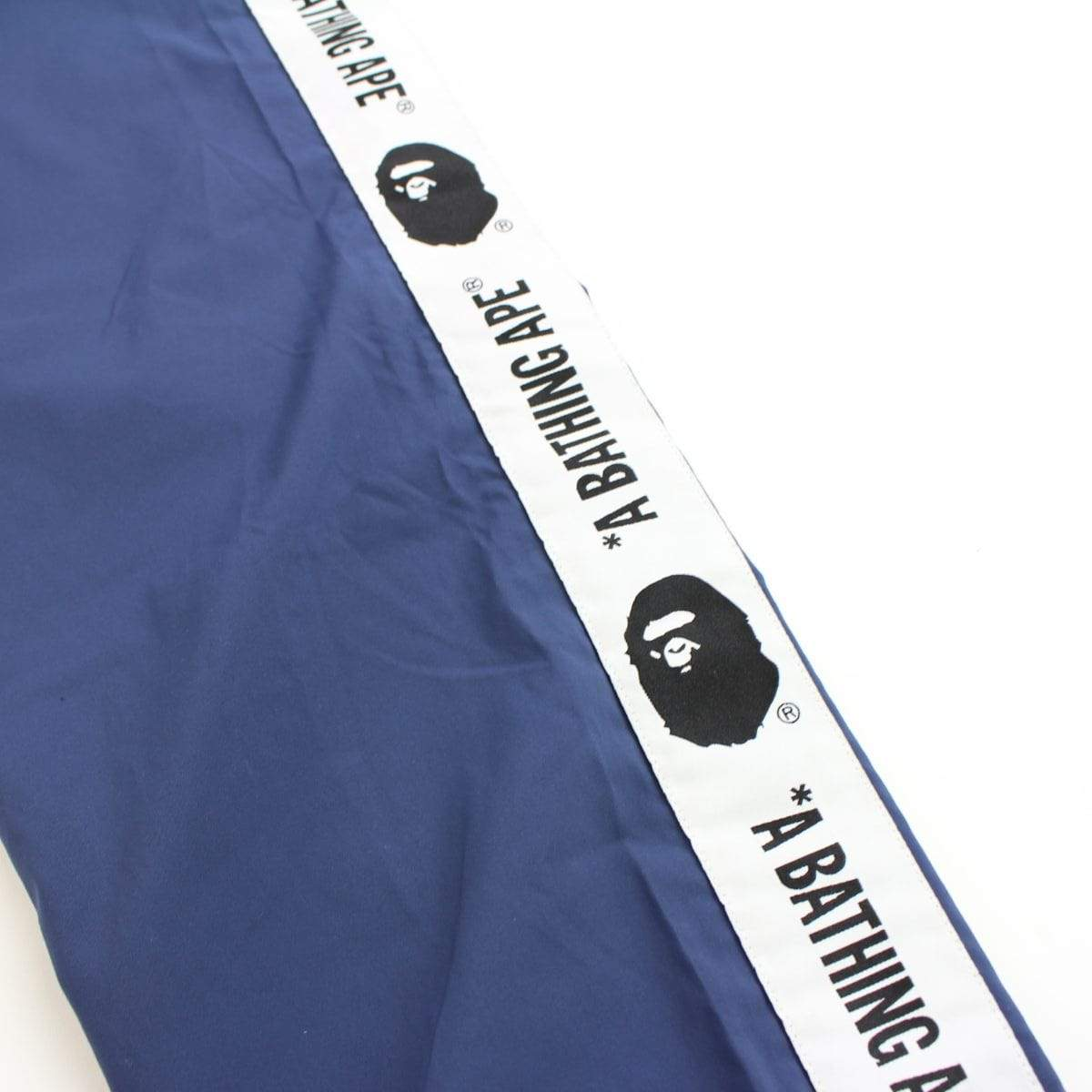 bape side strip track pants navy - SaruGeneral