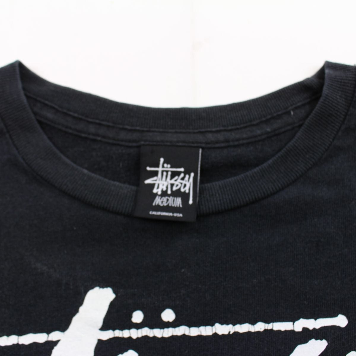 Stussy Cartoon Stores Text Logo Tee Black - SaruGeneral