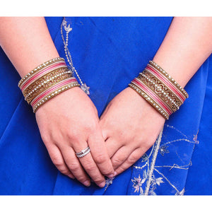 Intricate Bracelet With Running Stone Work And Shinning Bangle Set