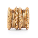 Set of 16 Golden Metal Bangle Set by Leshya