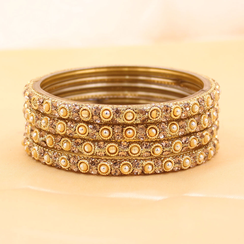 Set of 4 Golden Glass Bangles with Polki Beads by Leshya