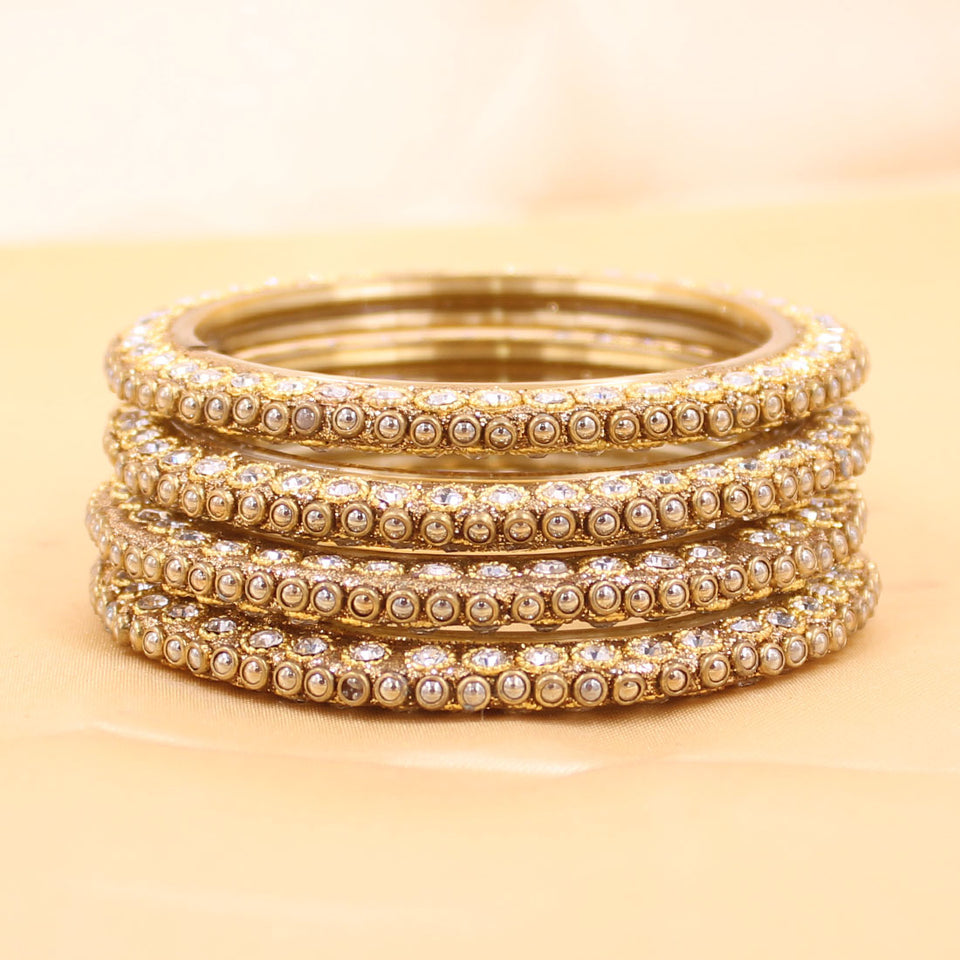 Set of 4 Glass Bangles with Running Golden Kundan by Leshya