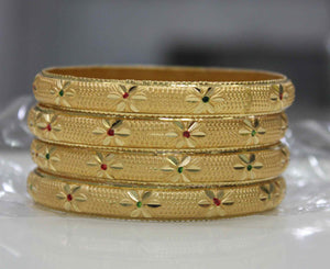 Beautiful Set Of 4 Gold Dyed Bracelets With Flower Design And Meenakari Work