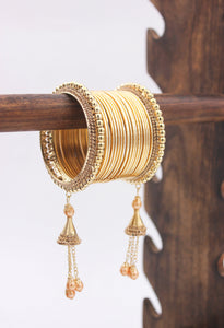 Golden Jhumki with Shining Metal Bangles by Leshya