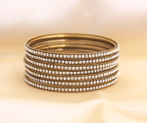 Set of 8 Running Stone Bangles by Leshya