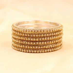 Brass Based Bangles with Golden Zari and Bead work by Leshya