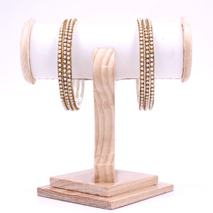 Brass Based Bangles with Running White Bead by Leshya