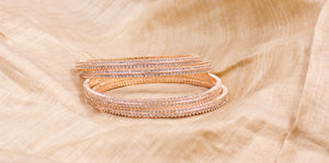 Beautiful Set of 4 Rose-Gold Running stone Bracelets by Leshya