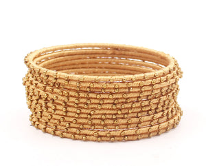 Thread Bangles Set of 12 with golden bearing by Leshya