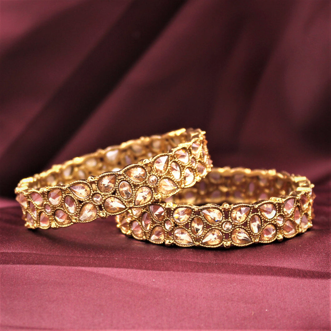 Traditional Antique Gold Bracelet Pair with Running Kundan Stones by Leshya