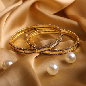 Pair Of Golden Bracelets With Golden Stonework For Daily Wear