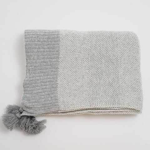 A Knit Lambswool Throw With Tassel