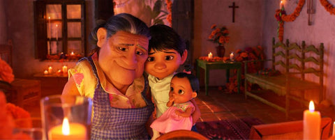 Miguel with Abuelita, and his little sister in Pixar's Coco