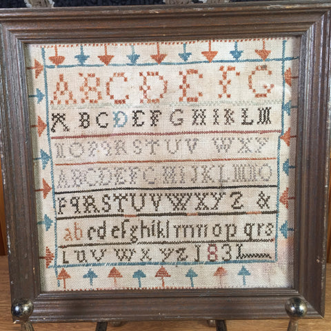 Antique alphabet needlework sampler