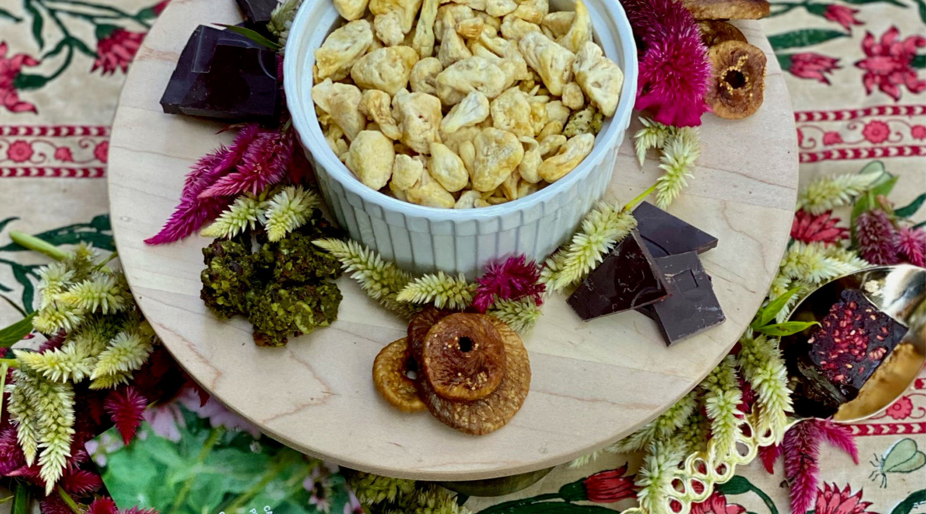 Entertaining Board, woodworking, artisan, artisanal, snacking, decadence, trendy, DADA Daily, chocolate, pistachio milk, figs, cauliflower, elevate your snacking moment, Let Us Entertain You