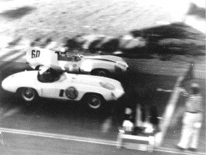 phil_hill_at_finish_line_1955