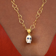 hand-carved bone skull pendant <br><i>with gemstone eyes (rubies, emeralds, or sapphires)</br></i>