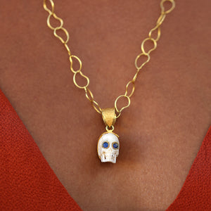 hand-carved bone skull with gemstone eyes (rubies, emeralds, or sapphires)