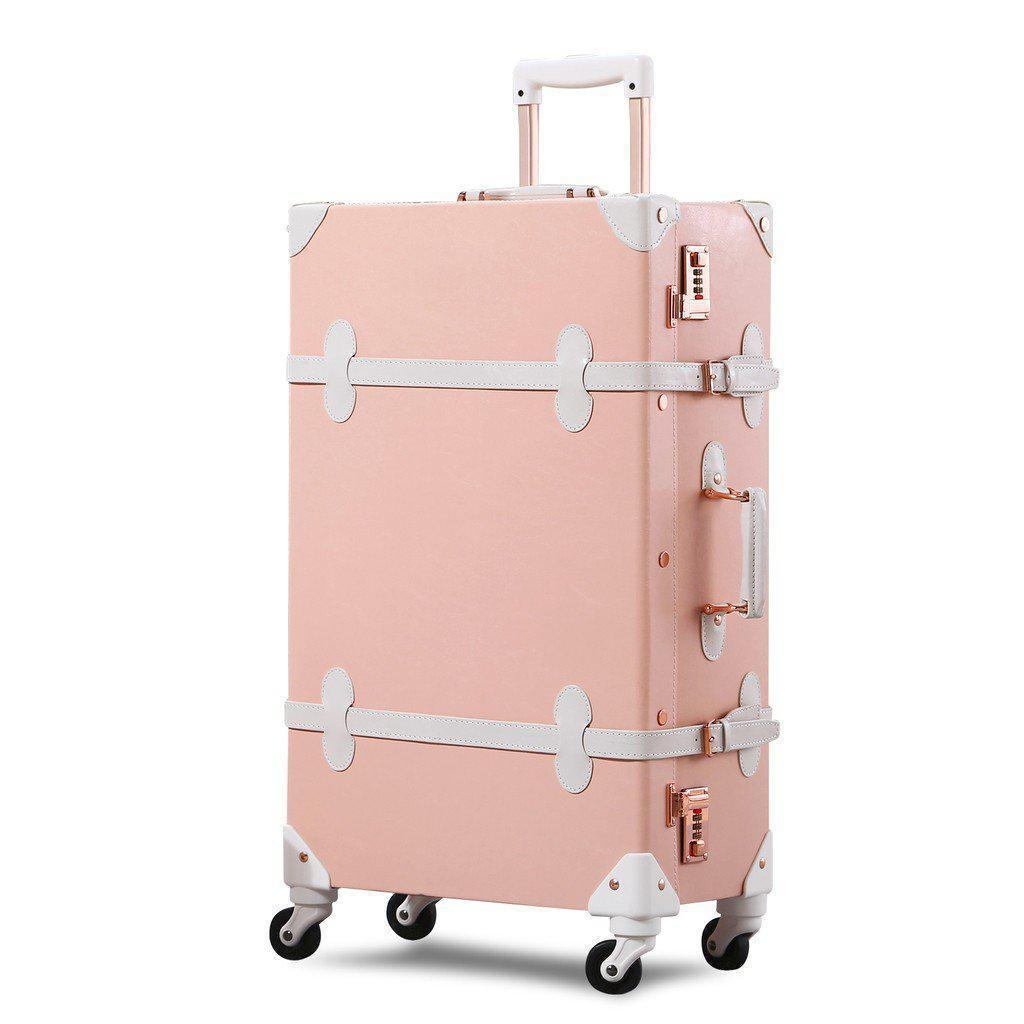 Light pink luxury travel luggage standing up