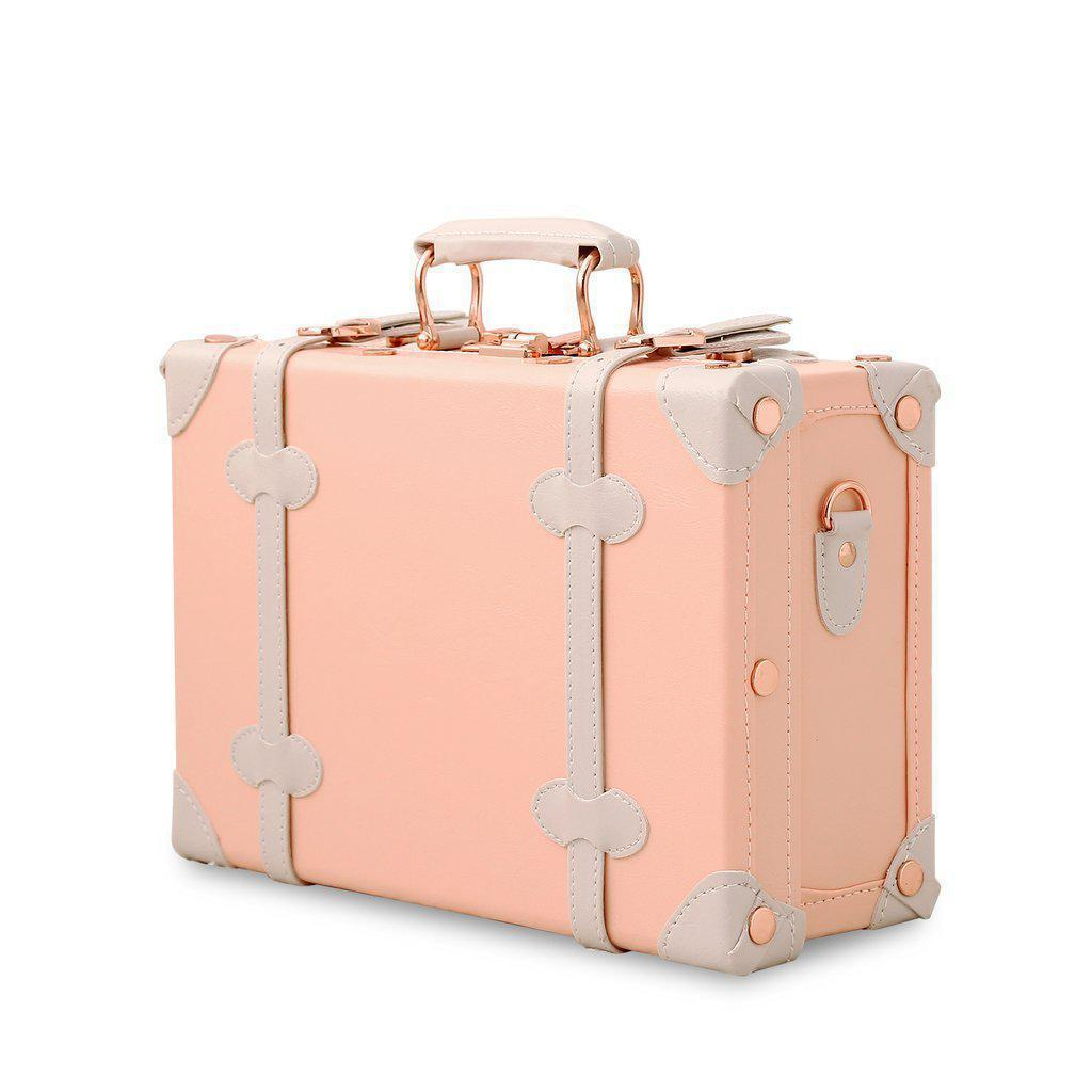 Light pink Vintage hardside luggage standing upright