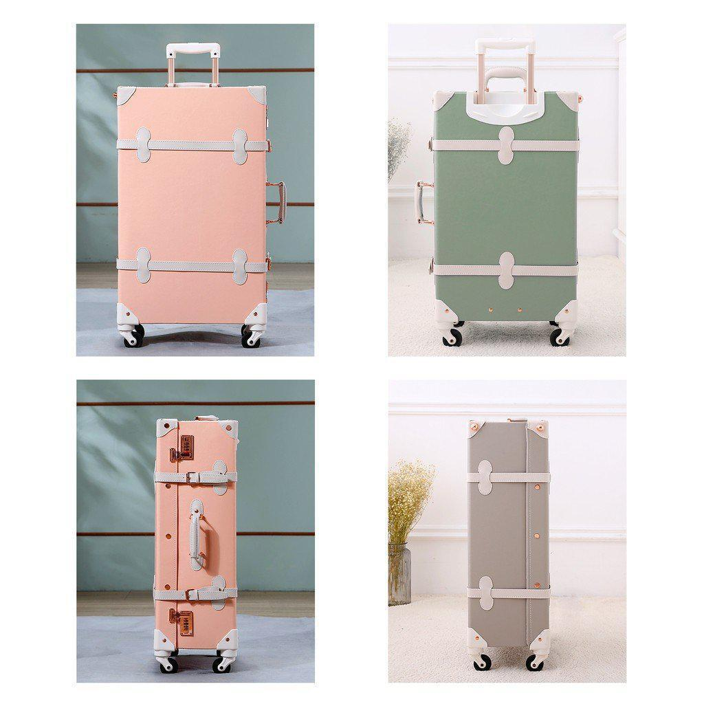 Pink and green luxury travel luggage standing upright in front of a couple different backgrounds