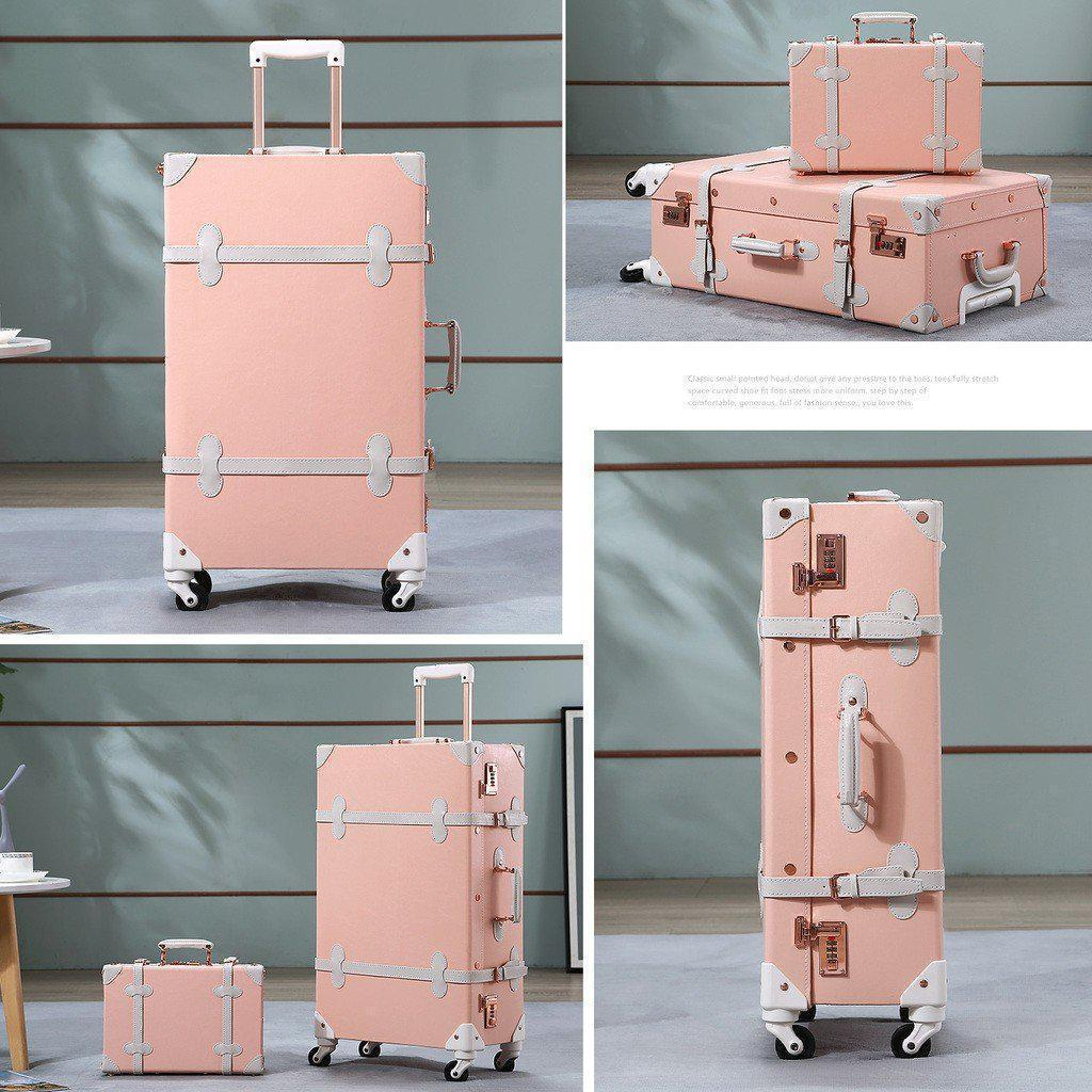 LIght pink luxury travel luggage 2 pc set in front of other backgrounds