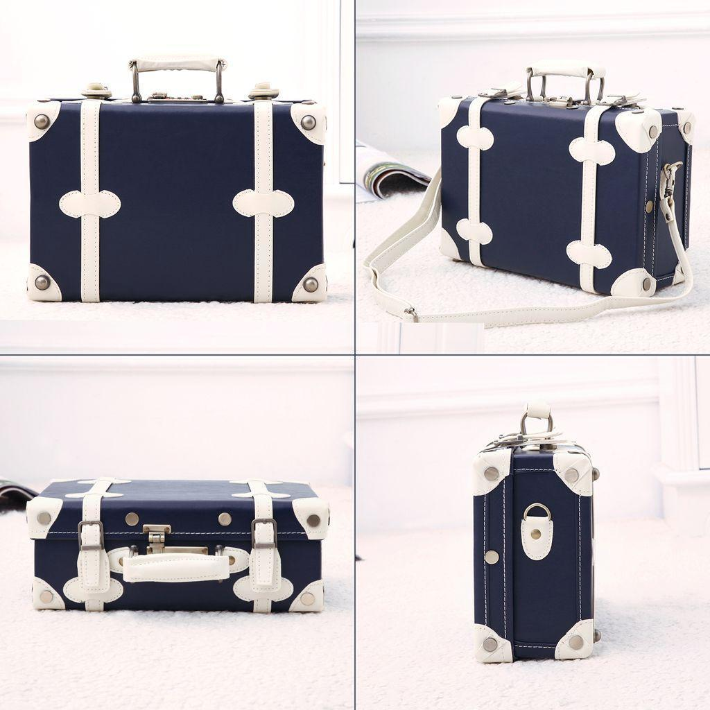 Dark blue Vintage hardside luggage shown in different frames