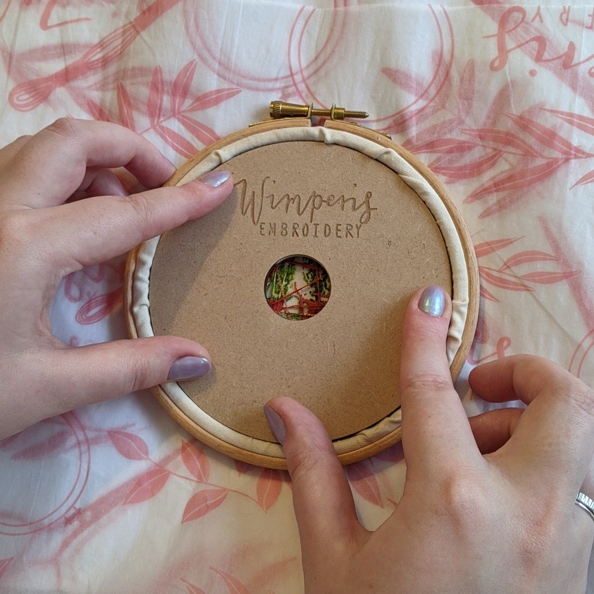 The Gamechanger - The revolutionary backing disk to finish and hang embroidery hoops.