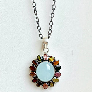 Oval Aquamarine and multicolored tourmaline pendant on blackened rhodium Emerson chain