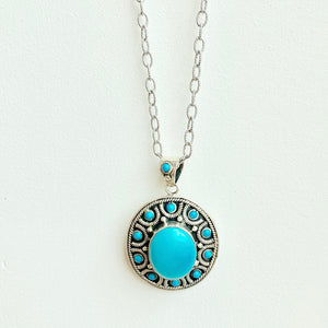 "20"" Turquoise pendant on rhodium chain"