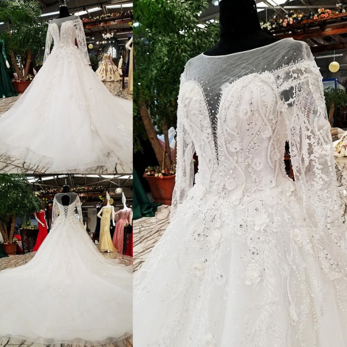 This stunning bridal illusion wedding dress will make your big day a memorable one. It's beautiful details and nice fabric makes this bridal gown one of a class for a high end luxurious wedding. Please use our size chart to pick the correct size our send us your measurement to custom make it for you. - elegantfashionstyle.com