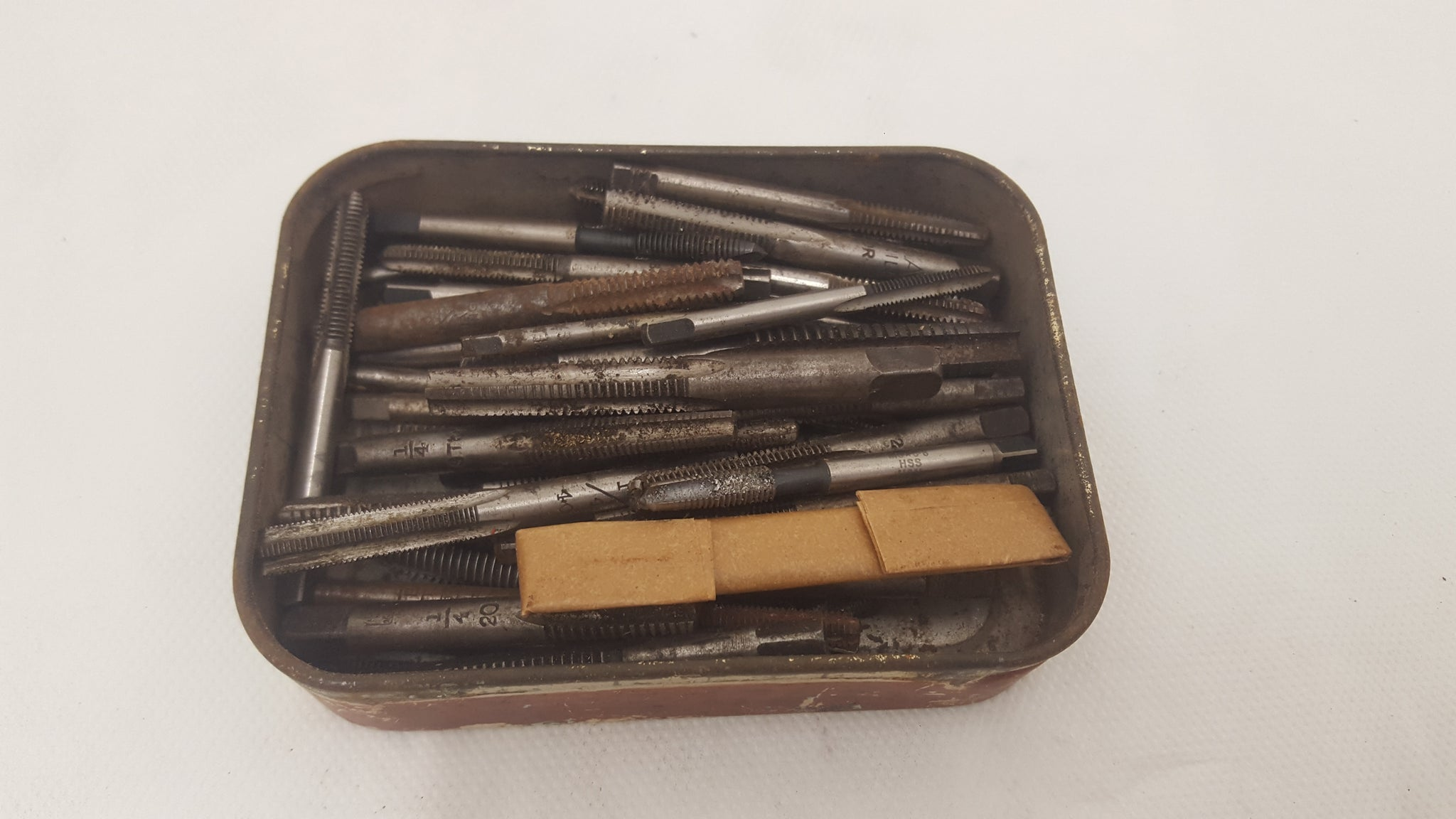 Vintage Tin of Assorted Taps 23765