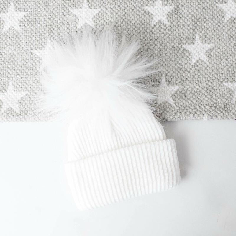 White faux fur hat