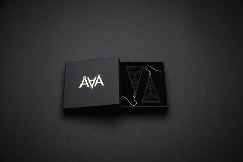 Aadra Collection Wooden Arrow somber black earrings with branded packaging