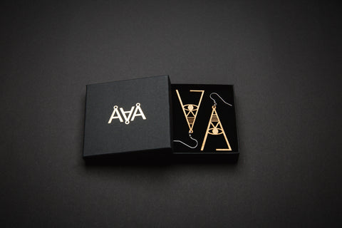 Aadra Collection Wooden Joy gold earrings with branded packaging
