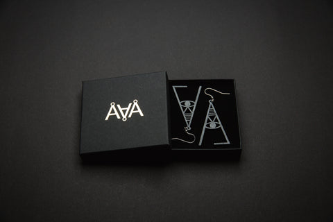 Aadra Collection Wooden Joy charcoal grey earrings with branded packaging