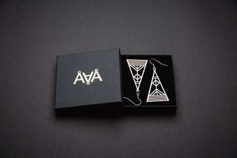 Aadra Collection Wooden Arrow pearl white earrings with branded packaging