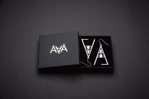 Aadra Collection wicked pearl white earrings with branded packaging
