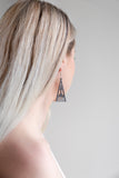 Aadra Collection grey Arrow design earrings on a models ear