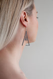 Aadra Collection Wooden Joy charcoal grey earrings on models ear
