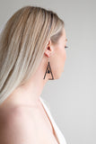 Aadra Collection Wooden Joy somber black earrings on models ear