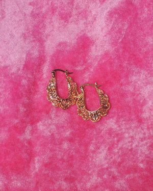 Beautiful all gold lace heart filigree hoops. The are almost oval shape but with scallop lace edges. Photographed on a pink velvet fabric background.