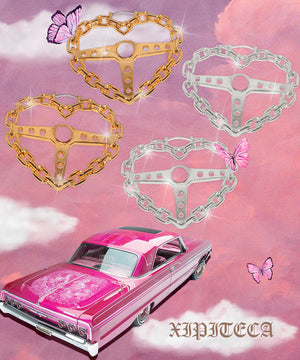 Heart Chain Link Steering Wheel Lowrider Hoop Earrings Vintage Nostalgic Hoop earrings on a pink and purple sky background. Pink lowrider on the left corner. What a beautiful lowrider dream escape. Pink and purple butterflies flirting with the heart steering wheel hoops. Live your lowrider dreams.